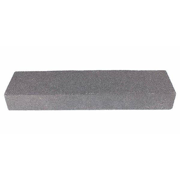 A solid grit block designed to shape and smooth cut tiles.