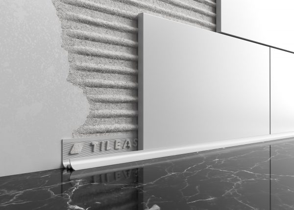 Worktop tile trim creates a neat transition from worktop to tiled wall