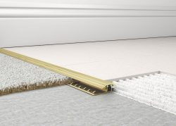 Screw down carpet to tile trim has been designed to give a neat transition between most hard flooring and carpets.